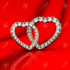 s day jewelry two diamond jewelry in the shape of hearts on a background