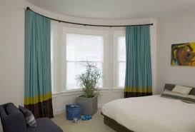 Bay Window Treatments For Bedroom - dining room decorated with patterned bay window curtains