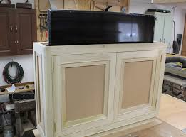 how to make a storage cabinet awesome disappearing tv cabinet how to build a hidden tv lift