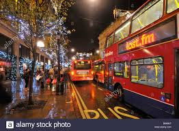 oxford street shoppers and christmas decorations london bus stock