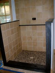 open shower with river rock base in master bath designing