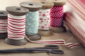 spools of ribbon wooden ribbon spools paper rolls and scissors stock photo
