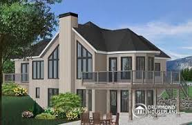 front sloping lot house plans sloping and hillside designs from drummondhouseplans com