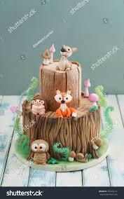enchanted forest woodland themed fondant cake stock photo