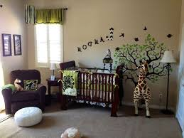 baby nursery children jungle themed bedroom with a ba cot stock