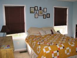 bedroom decorating ideas brown and cream tv above fireplace