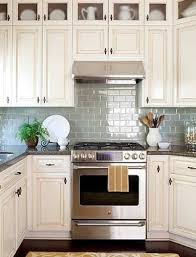 antique white kitchen cabinets with subway tile backsplash antique white glazed cabinets blue subway tile more