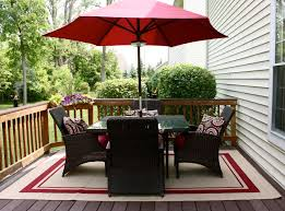 Pottery Barn Patio Furniture Romantic Red Parasol Above Black Pottery Barn Patio Furniture Set