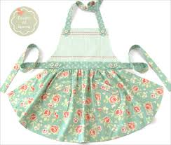 soft floral apron with curved skirt and button accents sewhome soft floral apron with curved skirt and button accents