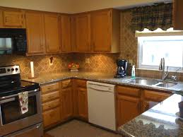 granite countertop over the fridge cabinet pic of backsplash