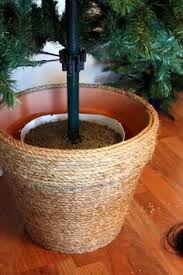 artificial christmas tree stand skip the christmas tree skirt and put the tree stand in a basket