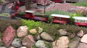 outdoor model train garden landscaped with succulent plants