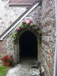 wedding flower arches uk church wedding flower arch http www alanlawphotography co uk