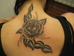 rose tattoo by black scorpion tattoos