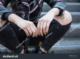 little cross tattoo on hand rocker stock photo 589350500