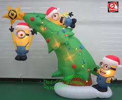 gemmy airblown 10 minions decorating a tree