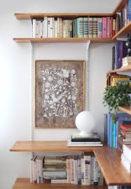 white gypsum wood own built in bookshelves escorted by fireplace