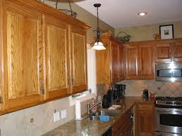 refacing oak kitchen cabinets light oak cabinets dark kitchen cabinets with dark countertops