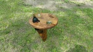 outdoor wine glass holder table he stuck the table into the ground grabbed a bottle of wine and