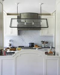 industrial glass and steel island pendant transitional kitchen