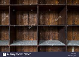Dark Wood Bookshelves by An Old And Distressed Dark Wood Shelf Made Of Empty Boxes