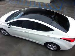 white lexus black roof car roof vinyl wrap installation service