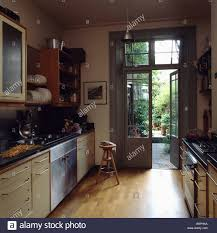 Galley Kitchen Images Wooden Flooring In Modern Galley Kitchen With French Doors Open To