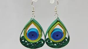 peacock feather earrings s how to make quilling peacock feather earrings diy tutorial free
