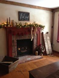decorating a colonial home gas fireplace with colonial mantle style decorated for a primitive