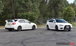 mitsubishi lancer evo 1 2016 mitsubishi lancer evolution vs subaru wrx sti comparison