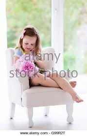 Pink Peonies Bedroom - little smelling peony flower bouquet sitting in a white chair