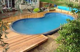 Above Ground Pool Ideas Backyard Oval Above Ground Pool With Wooden Deck Entrance Bexar County