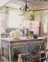shabby chic kitchen with vintage island and chairs and pink