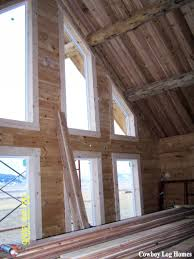 interior of solid log gable wall of log home cowboy log homes