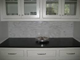 backsplash for black and white kitchen glass front cabinets glass knobs marble mini tile backsplash