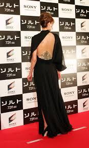 angelina jolie at salt japan premiere in backless slashed leg