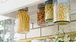 48 kitchen storage hacks and solutions for your home mason jars screwed into the underside of a cabinet is a creative kitchen storage hack