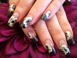 charcoal grey polish with one stroke flower freehand nail art on
