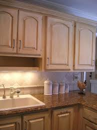 antique white kitchen cabinets with black appliances granite tile