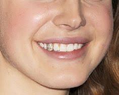 diamond stud in tooth possum necklace