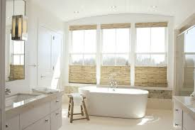 crisp muslin bathroom beach style with arched ceiling foot tub