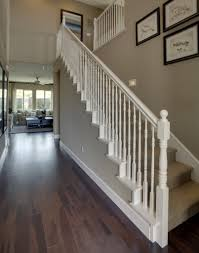 love the white banister wood floors and the wall color exactly
