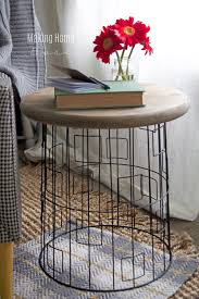 diy accent table from a wire laundry basket wire basket wood