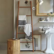 Modern Bathroom Dominated With Rattan Ladder Stand Bathroom Towel