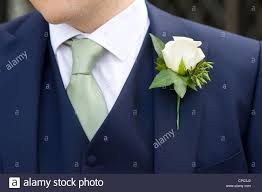 wedding flowers buttonholes at a wedding wearing a floral buttonhole stock photo royalty