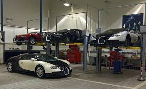4 bugatti veyrons one garage nice garages pinterest 4 bugatti veyrons one garage