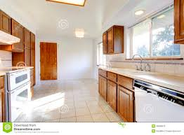 white kitchen cabinets with tile floor white kitchen room with brown cabinets stock photo image