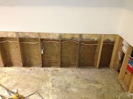 repair damaged drywall with a water resistant half wall