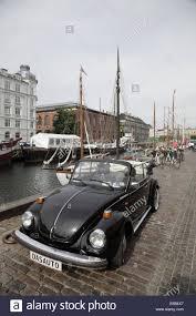 volkswagen beetle background a classic black volkswagen beetle car in nyhavn copenhagen