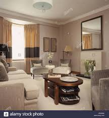 Hotel Drapes Beige Sofas And Carpet In Hotel Room With Cream Drapes With Wide